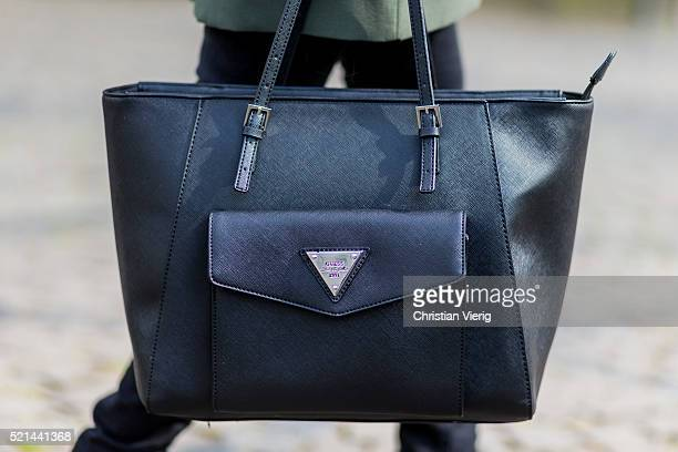 Fashion model Jueli Mery a green jacket from Forever 21, a black Topshop top, black denim jeans from Zara and a black Guess bag April 14, 2016 in...