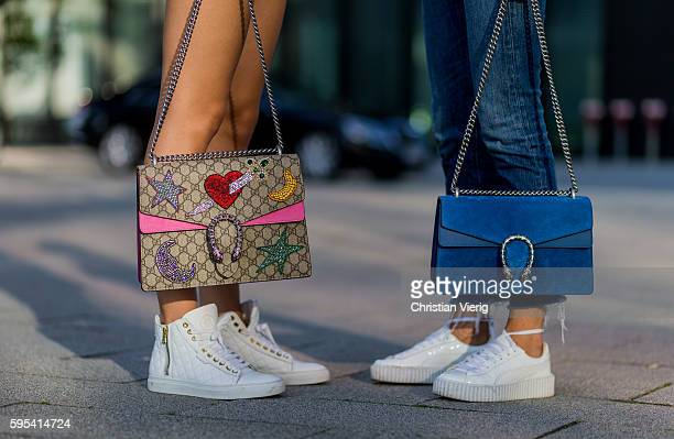 Fashion model Jueli Mery and Lisa Hahnbueck wearing Gucci Dionysus bag white Michalsky sneaker and white Puma Fenty Sneaker and blue Gucci Dionysus...