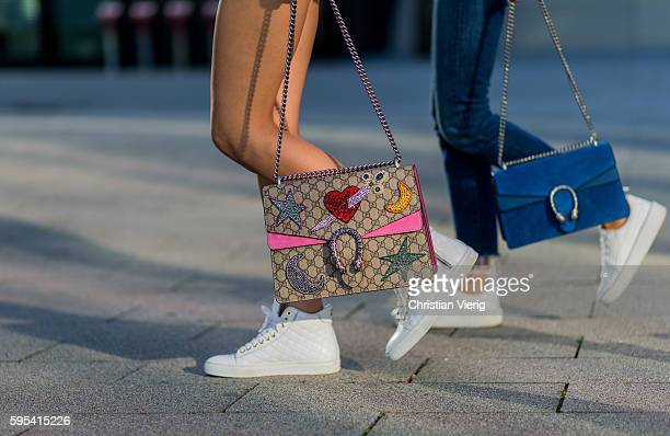 Fashion model Jueli Mery and Lisa Hahnbueck wearing Gucci Dionysus bag, white Michalsky sneaker and white Puma Fenty Sneaker and blue Gucci Dionysus...