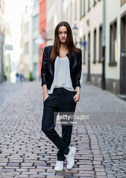 Fashion model Jueli Mery wearing a black jogger pants and white top from Zara, black leather jacket from Only and white Adidas sneaker April 14, 2016...