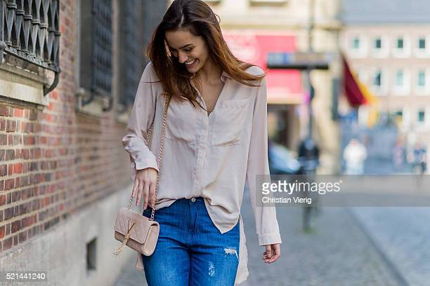 Fashion model Jueli Mery wearing blue ripped denim jeans from Forever 21, a nude button shirt from Costes, a Valentino mini bag on April 14, 2016 in...