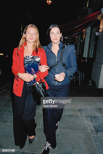 Fashion model Kate Moss walking in London with actress Liv Tyler 28th April 1998