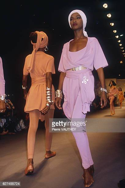 Fashion model Katoucha wears a matching pastel readytowear shirt and pants outfit by German fashion designer Karl Lagerfeld She modeled the outfit...