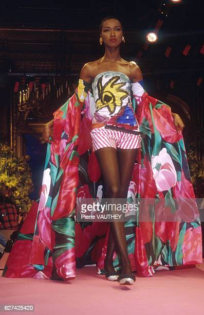 Fashion model Katoucha wears a strapless floral print haute couture outfit by French fashion designer Christian Lacroix She modeled the outfit during...