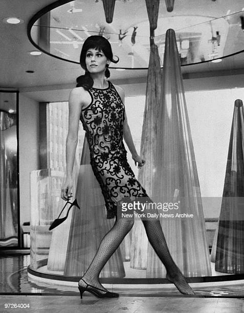 Fashion model Lauren Hutton modeling a Lucrezia Borgia style dress created by designer Chuck Howard during the dedication of the new Allied Chemical...