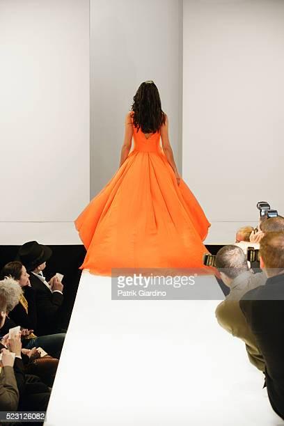 fashion model leaving runway - laufsteg stock-fotos und bilder