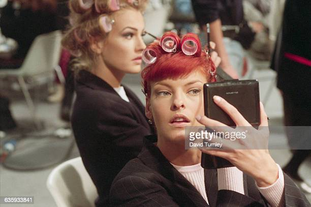 Fashion model Linda Evangelista prepares for a fashion show at the Musee du Louvre in Paris France Visible in the background is model Karen Mulder...