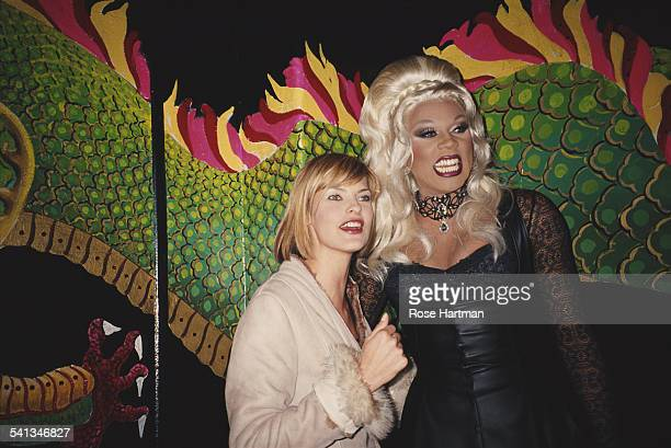 Fashion model Linda Evangelista with RuPaul at an 'Out' magazine party 1992