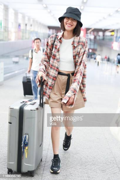 Fashion model Liu Wen is seen at airport on August 19, 2019 in Beijing, China.