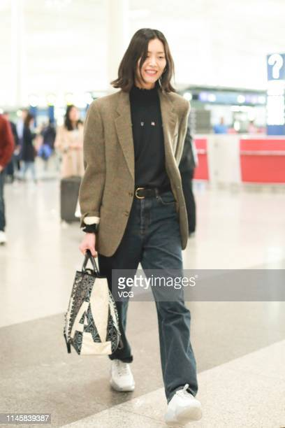 Fashion model Liu Wen is seen at Beijing Capital International Airport on April 28 2019 in Beijing China