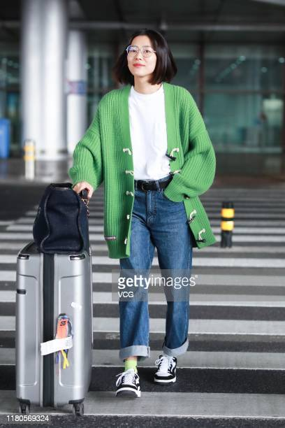 Fashion model Liu Wen is seen at Beijing Capital International Airport on October 12 2019 in Beijing China