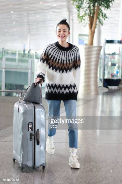 Fashion model Liu Wen is seen at Beijing Capital International Airport on October 21 2017 in Beijing China
