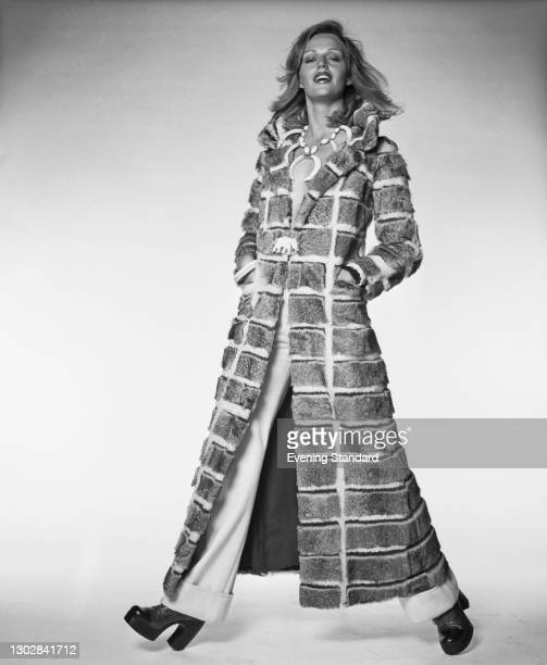 Fashion model Madeleine Backlund wearing a full-length patterned fur coat with an elephant motif, UK, 3rd October 1972.
