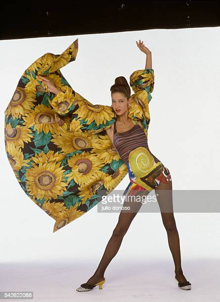 Fashion model Marpessa wears a haute couture minidress and long jacket decorated with sunflower patterns by French fashion designer Christian Lacroix...