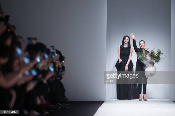 Fashion model Ming Xi Mengyao and actress Carina Lau attend ANIRAC collection by Carina Lau during the Shanghai Fashion Week Autumn/Winter 2017 at...