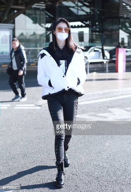 Fashion model Ming Xi Mengyao arrives at Beijing Capital International Airport on November 22 2017 in Beijing China