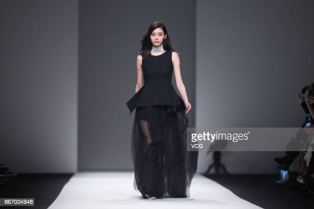 Fashion model Ming Xi Mengyao showcases designs on the runway during ANIRAC collection by actress Carina Lau during the Shanghai Fashion Week...
