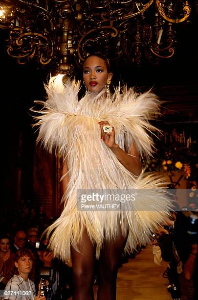 Fashion model Naomi Campbell wears a furry cocktail dress by French fashion designer Yves Saint Laurent at his autumn-winter 1987-1988 fashion show...