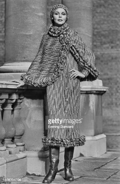 Fashion model Nola wearing a knitted dress and cap with a looped trim, UK, 26th September 1974.