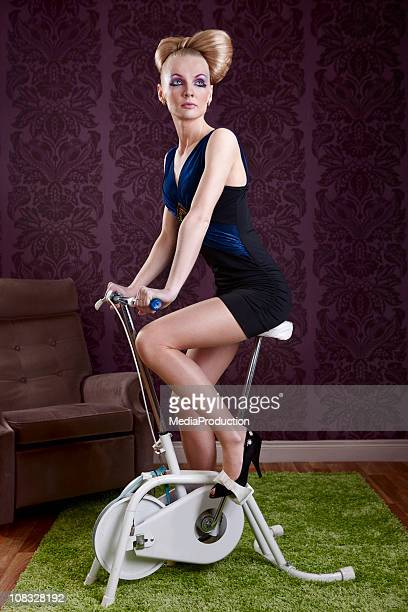 fashion model on an exercise bike