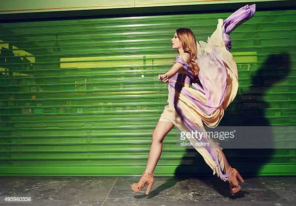 fashion model on catwalk - catwalk stage stock pictures, royalty-free photos & images