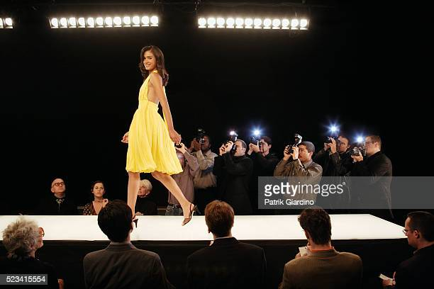 fashion model on runway - fashion runway stock pictures, royalty-free photos & images