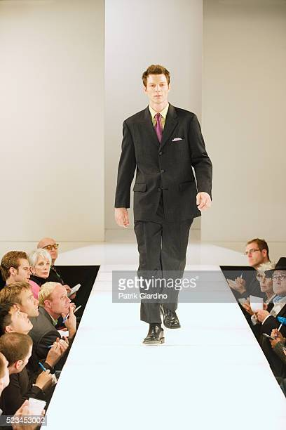 fashion model on runway - catwalk stock pictures, royalty-free photos & images