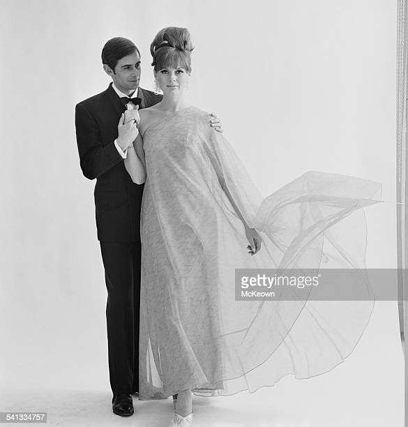 Fashion model Paulene Stone shows a long evening dress in nylon organza by Jean Allen 15th March 1967