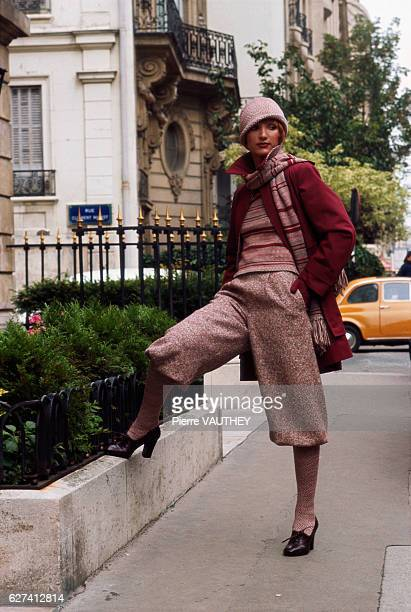A fashion model poses in the streets of Paris in women's readytowear fashions from the 19741975 FallWinter collection of French fashion house Guy...
