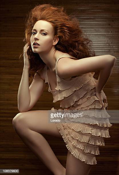 fashion model posing in beautiful dress - fringe dress stock photos and pictures