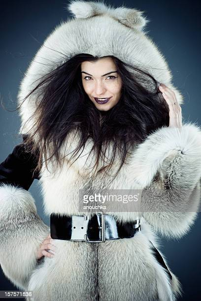 fashion model posing in fox fur coat - gray fox stock photos and pictures
