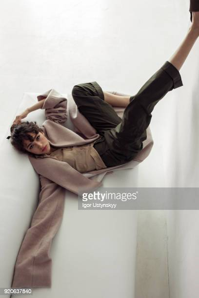 fashion model posing in long coat - haute couture stock pictures, royalty-free photos & images