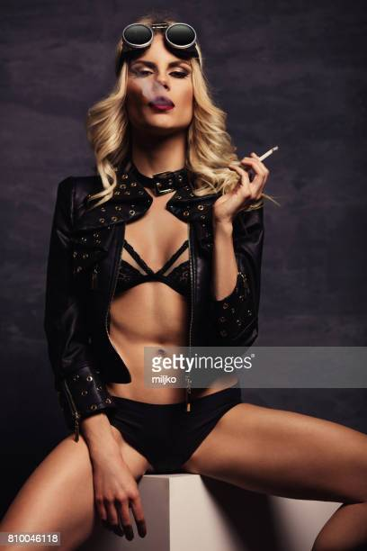 fashion model posing in studio - beautiful women smoking cigarettes stock photos and pictures