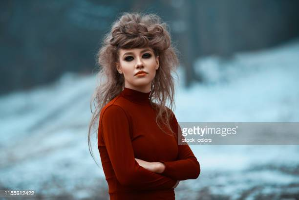fashion model posing lonely in winter - smokey eyeshadow stock pictures, royalty-free photos & images