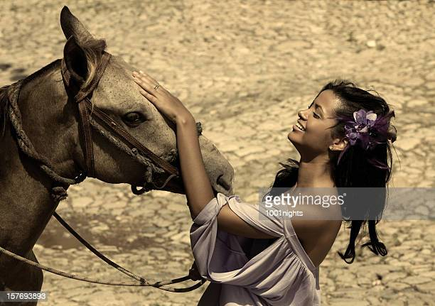 Fashion Model posing with horse