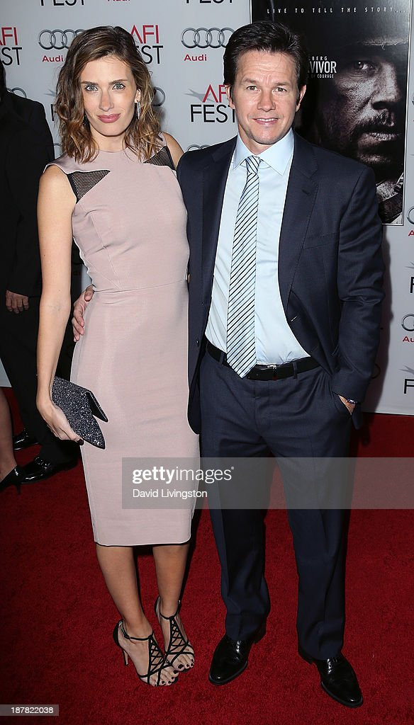 Fashion model Rhea Durham (L) and husband actor Mark Wahlberg attend the AFI FEST 2013 presented by Audi premiere of 'Lone Survivor' at the TCL Chinese Theatre on November 12, 2013 in Hollywood, California.