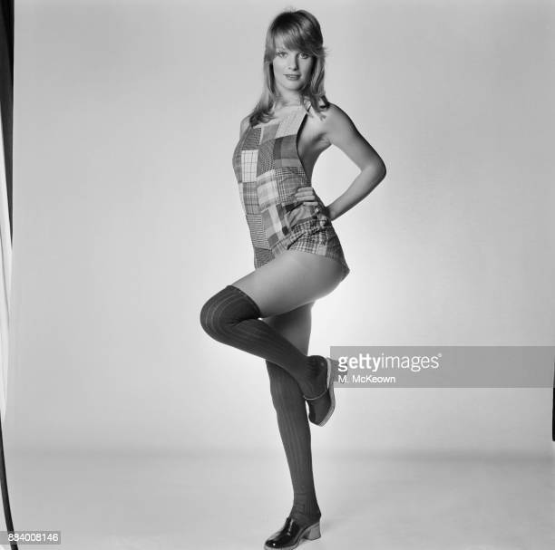 Fashion model Sally Bodington wearing a patched playsuit, over the knee socks and clogs, UK, 19th March 1971.