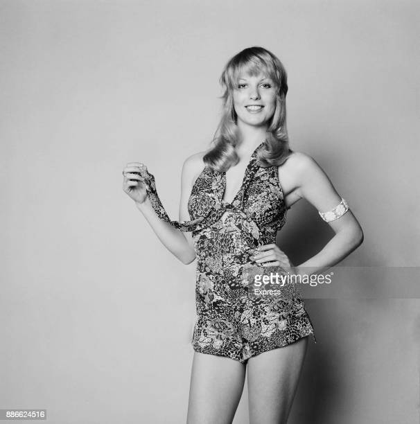 Fashion model Sally Bodington wearing a sleveless floral playsuit UK 10th May 1971