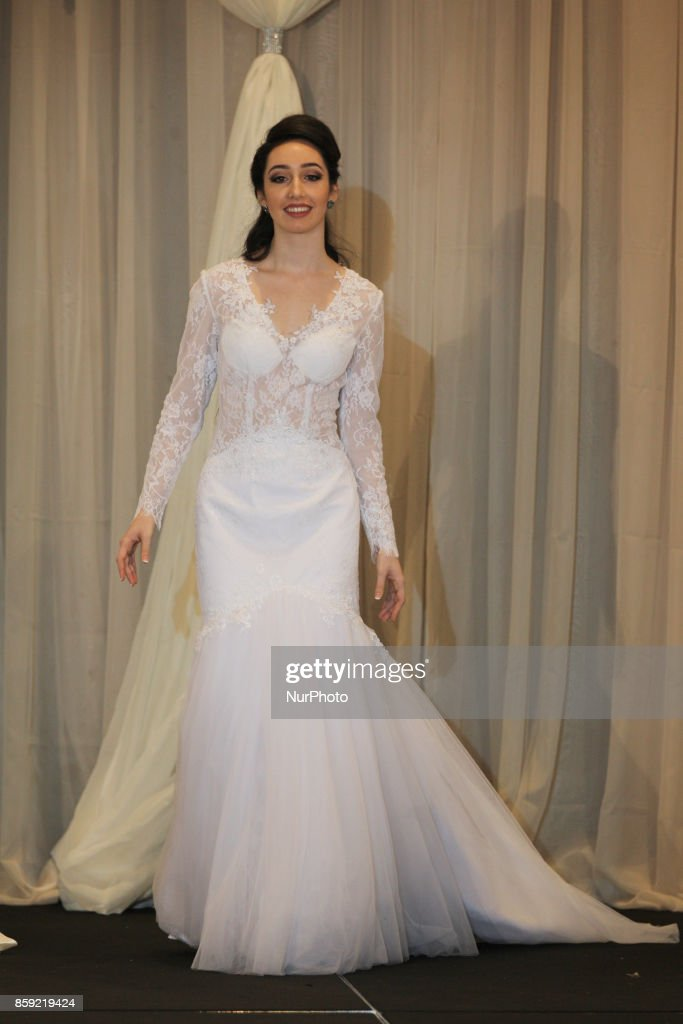 Fashion Model Showcases An Elegant Wedding Gown During A Bridal Show Held In Mississauga