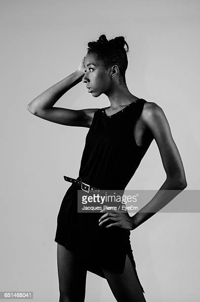 Fashion Model Standing Against White Background