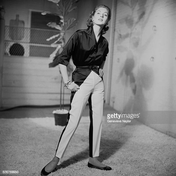 Fashion model Suzy Parker wears a casual shirt and trousers set