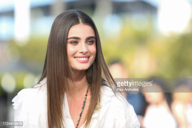 """Fashion Model Taylor Hill visits the set of """"Extra"""" at Universal Studios Hollywood on January 24, 2019 in Universal City, California."""