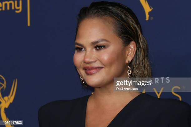 Fashion Model / TV Personality Chrissy Teigen poses in the press room of the 2018 Creative Arts Emmy Awards Day 2 at Microsoft Theater on September 9...