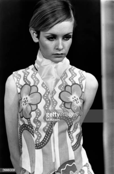 Fashion model Twiggy displays the line of clothing she intends to market in America