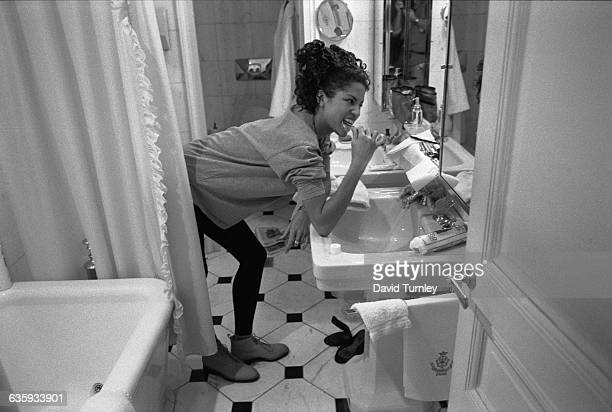 Fashion model Veronica Webb brushes her teeth in her hotel room before a fashion show in Paris.