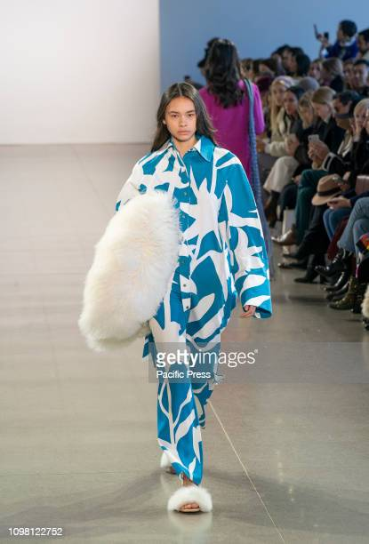 Fashion model walks the runway for Claudia Li collection during Fall/Winter 2019 fashion week at Spring Studios.