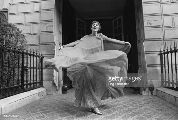 A fashion model wearing a chiffon evening gown by Christian Dior UK 30th July 1971