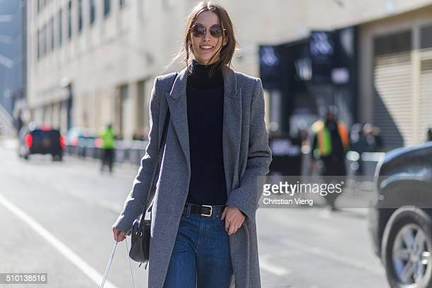 A fashion model wearing a long grey wool coat seen outside Yigal Azrouel during New York Fashion Week Women's Fall/Winter 2016 on February 12 2016 in...