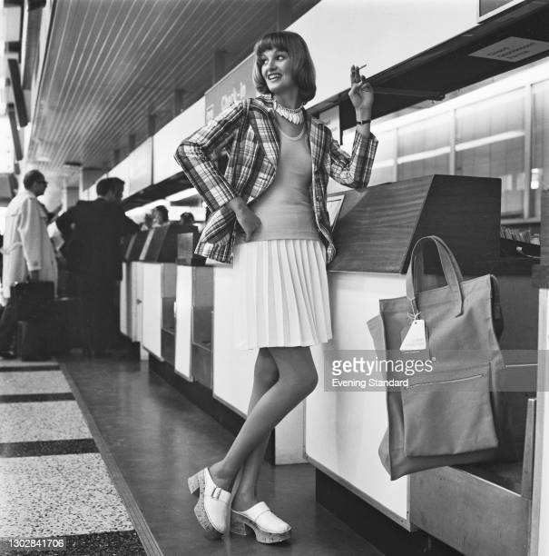 Fashion model wearing a Madras blazer at the airport, UK, 3rd July 1972.