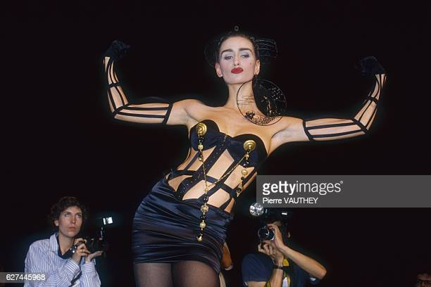 A fashion model wearing a readytowear corset with bustier by French fashion designer Jean Paul Gaultier She is modeling the outfit during his...